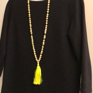 Jewelry - Wood bead necklace with yellow cotton tassel.